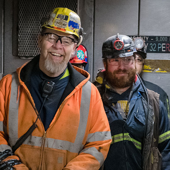 Two workers smiling